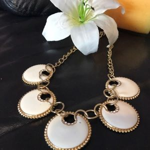 Gold tone circles with white and sparkle 🌺
